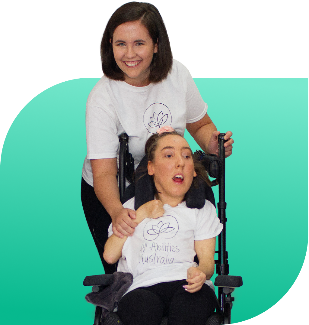Teacher, Miss Annabelle and a student sitting in her wheelchair are posing happily for a photo with their All Abilities Australia shirts